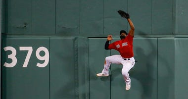 Jackie Bradley Jr. scales the wall in center at Fenway Park