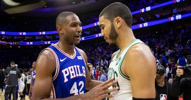 Sixers forward Al Horford talks to his old Celtics teammate Jayson Tatum
