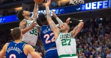 Marcus Smart battles for an offensive rebound in Sacramento