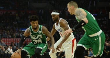 Marcus Smart and Daniel Theis try to create offense against the Clippers