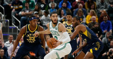 Jayson Tatum goes against two Pacers
