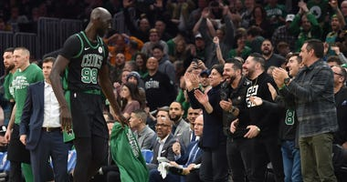 Celtics fans cheer on Tacko Fall during a game at the Garden