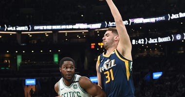 Jazz forward Georges Niang defends Celtics forward Semi Ojeleye