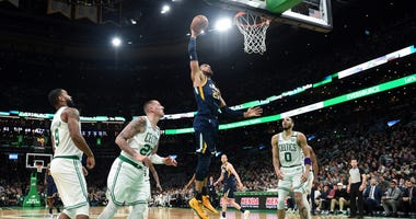Rudy Gobert flies toward the rim against the Celtics in Boston
