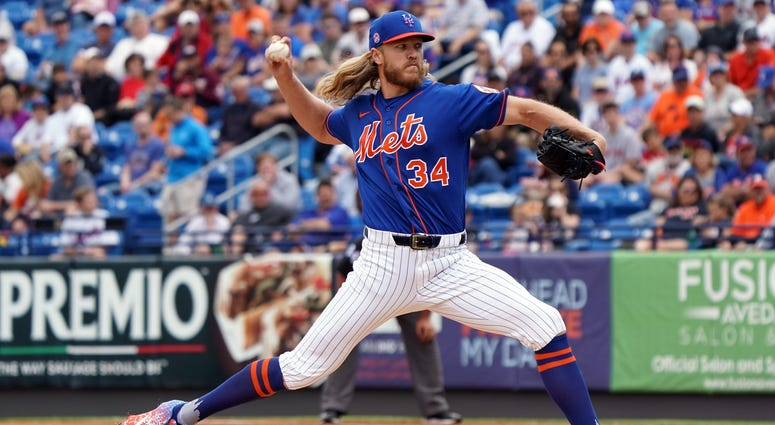 Noah Syndergaard delivers a pitch