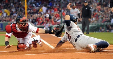 Christian Vazquez tags out Leonys Martin.