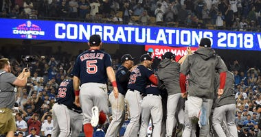 Red Sox celebrate on the field after winning the 2018 World Series