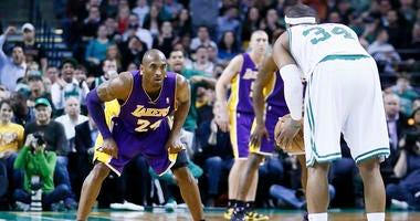Kobe Bryant guards Paul Pierce