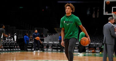 Romeo Langford warms up before a Celtics game