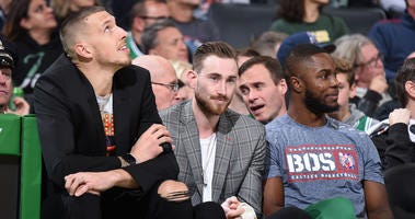 Gordon Hayward watches his Celtics teammates work while he is still sidelined