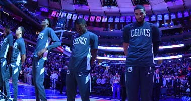 The Celtics await the start of their game against the Knicks on Sunday