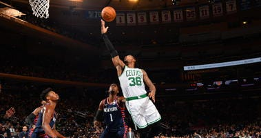 Marcus Smart drives against the Knicks