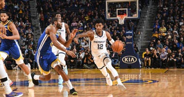 Ja Morant drives against the Warriors in his return for the Grizzlies