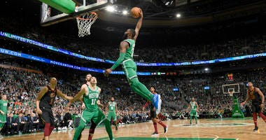 Jaylen Brown takes off for the rim