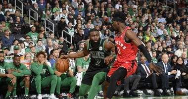 Jaylen Brown tries to drive against Terence Davis