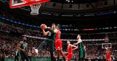 Enes Kanter battles in the pain against the Bulls