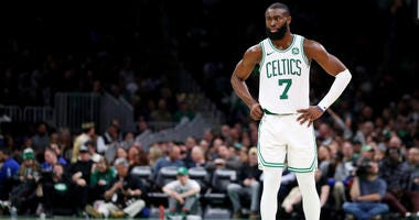 Jaylen Brown takes a second to gather himself while playing the Heat