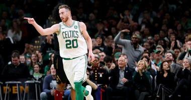 Gordon Hayward celebrates a play against the Cavs with his Celtics teammates