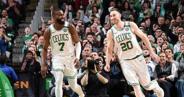 Jaylen Brown and Gordon Hayward celebrate a big play against the Bulls