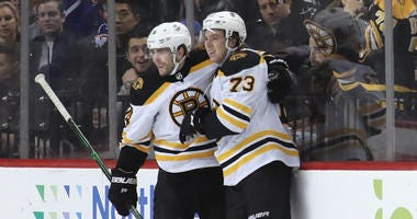 Charlie McAvoy Jake DeBrusk Boston Bruins