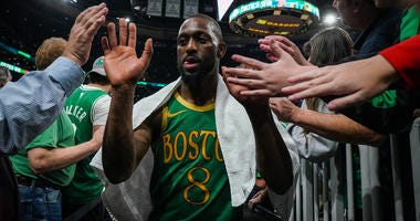 Kemba Walker is greeted by fans after Wednesday's win