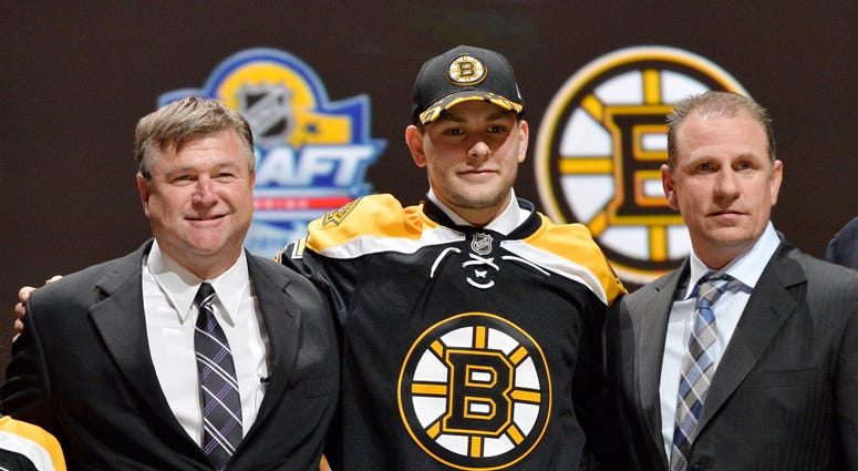 Jun 26, 2015; Sunrise, FL, USA; Jakub Zboril poses for a photo with team executives after being selected as the number thirteen overall pick to the Boston Bruins in the first round of the 2015 NHL Draft at BB&T Center. Mandatory Credit: Steve Mitchell-USA