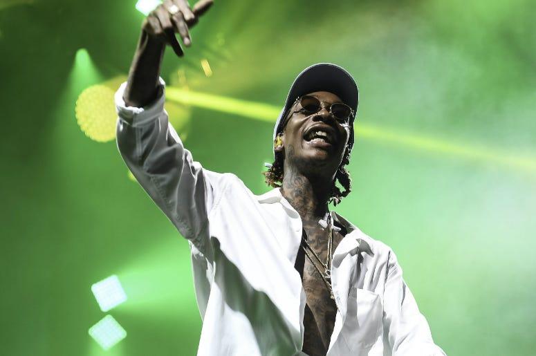 July 20, 2016; West Palm Beach, FL, USA; Recording artist Wiz Khalifa performs at the Perfect Vodka Amphitheatre.