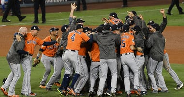 The Houston Astros celebrate defeating the Los Angeles Dodgers in Game 7 to win the 2017 World Series at Dodger Stadium on Nov. 1, 2019.