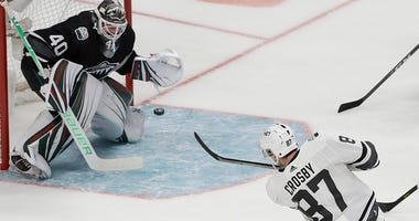 Metropolitan Division's Sidney Crosby, of the Pittsburgh Penguins, scores a goal past Central Division's Devan Dubnyk, of the Minnesota Wild, during the first half of the NHL hockey All-Star Game final in San Jose, Calif., Saturday, Jan. 26, 2019.