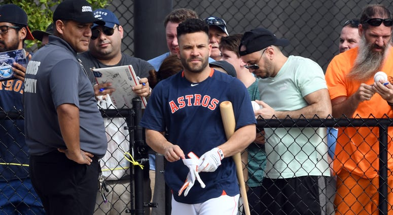 The Astros' Jose Altuve finishes signing autographs before the morning spring training workout on Feb. 13, 2020, in West Palm Beach, Florida.