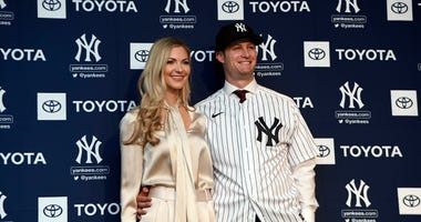 Amy and Gerrit Cole are introduced with the Yankees.