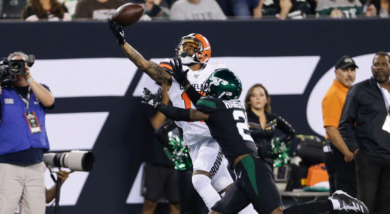 Cleveland Browns' Odell Beckham (13) catches a pass in front of New York Jets' Nate Hairston (21) during the first half of an NFL football game Monday, Sept. 16, 2019, in East Rutherford, N.J