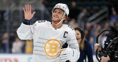 Boston Bruins forward David Pastrnak waves to the crowd as he is named the most valuable player of the NHL hockey All Star games Saturday, Jan. 25, 2020, in St. Louis.
