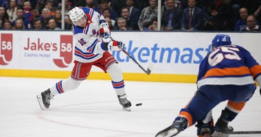 Rangers left wing Artemi Panarin shoots against the Islanders on Feb. 25, 2020, at Nassau Veterans Memorial Coliseum.