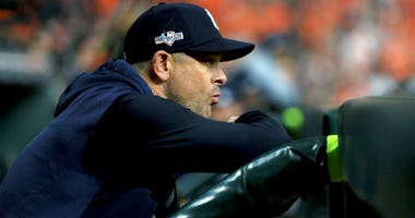 Aaron Boone of the Yankees looks on against the Houston Astros during the sixth inning in game one of the American League Championship Series at Minute Maid Park on October 12, 2019 in Houston, Texas.