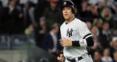 Aaron Judge of the Yankees comes home to score a run on a walk against the Houston Astros during the first inning in game four of the American League Championship Series at Yankee Stadium on October 17, 2019 in New York City.