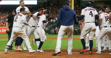 Jose Altuve of the Houston Astros comes home to score after his walk-off two-run home run to win game six of the American League Championship Series 6-4 against the Yankees at Minute Maid Park on October 19, 2019 in Houston, Texas.