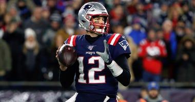 New England Patriots quarterback Tom Brady looks to pass against the Kansas City Chiefs on Dec. 8, 2019, at Gillette Stadium in Foxborough, Massachusetts.
