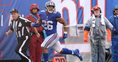 Giants running back Saquon Barkley runs for a touchdown against the Jacksonville Jaguars on Sept. 9, 2018, at MetLife Stadium.