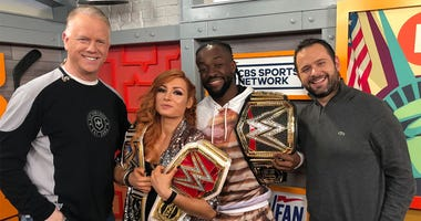 WWE champs Becky Lynch and Kofi Kingston pose with Boomer and Gio on April 8, 2019.