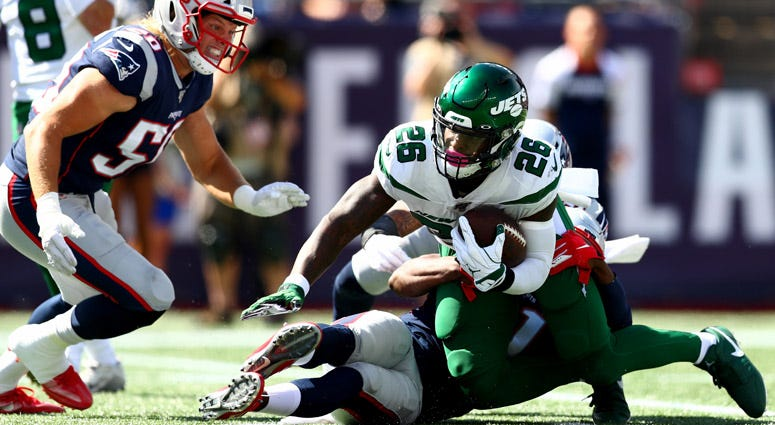 The Jets' Le'Veon Bell is tackled by the New England Patriots on Sept. 22, 2019, at Gillette Stadium in Foxborough, Massachusetts.
