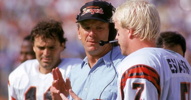 Cincinnati Bengals coach Sam Wyche talks to quarterback Boomer Esiason on the sidelines during a game against the Los Angeles Rams on Oct. 7, 1990, at Anaheim Stadium in Anaheim, California.