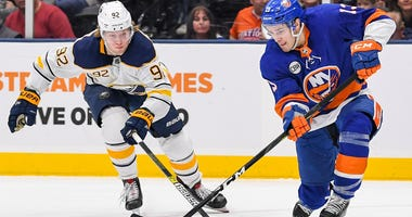 Mar 30, 2019; Islanders center Mathew Barzal attempts a shot defended by Buffalo Sabres right wing Alexander Nylander (92) during the second period at Nassau Veterans Memorial Coliseum. Dennis Schneidler-USA TODAY Sports