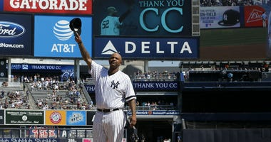 NEW YORK, NEW YORK - SEPTEMBER 22: CC Sabathia #52 of the New York Yankees salutes the crowd as he is honored prior to a game against the Toronto Blue Jays at Yankee Stadium on September 22, 2019 in the Bronx borough New York City. CC Sabathia is retiring