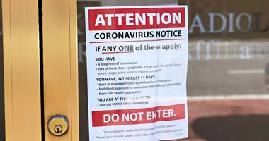 A coronavirus notice is posted in the window of Lenox Hill Radiology in Manhattan on March 15, 2020, as the coronavirus continues to spread across the United States.