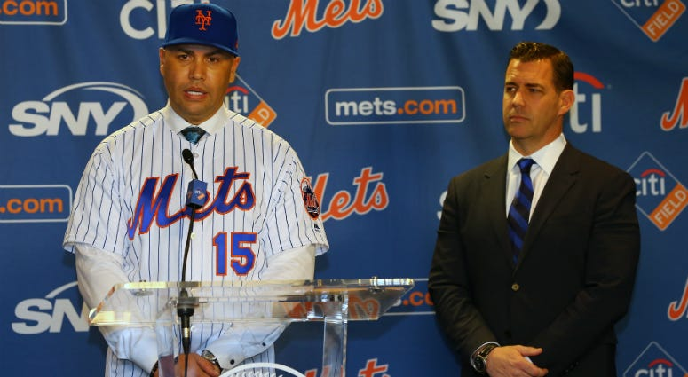 Carlos Beltran talks after being introduced by General Manager Brodie Van Wagenen, right, during a press conference at Citi Field on November 4, 2019 in New York City.