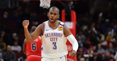 Oklahoma City Thunder guard Chris Paul (3) reacts after scoring in the first half against the Chicago Bulls at United Center