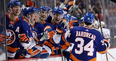 NEW YORK, NEW YORK - NOVEMBER 05: Cole Bardreau #34 of the New York Islanders celebrates scoring his first NHL goal in the second period against Craig Anderson #41 of the Ottawa Senators during their game at Barclays Center on November 05, 2019 in New Yor