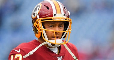 Washington Redskins quarterback Colt McCoy (12) looks on prior to the game against the Buffalo Bills at New Era Field