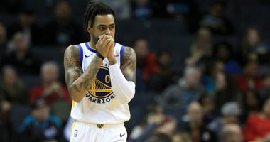 D'Angelo Russell of the Golden State Warriors watches on against the Charlotte Hornets during their game at Spectrum Center on December 04, 2019 in Charlotte, North Carolina.